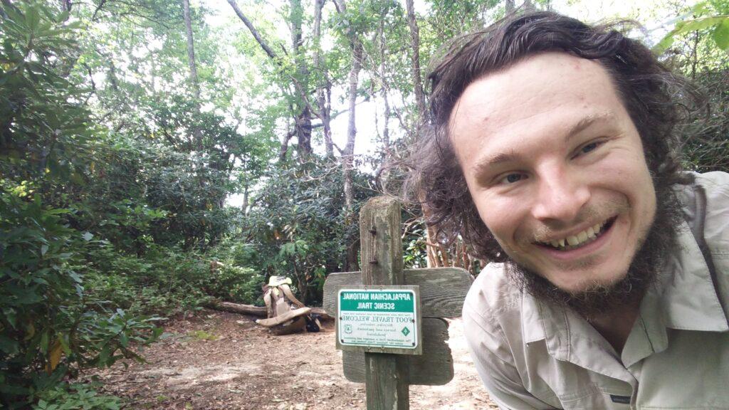 Dr. Matthew Pearce smiles for a selfie at an Appalachian Trail trail head