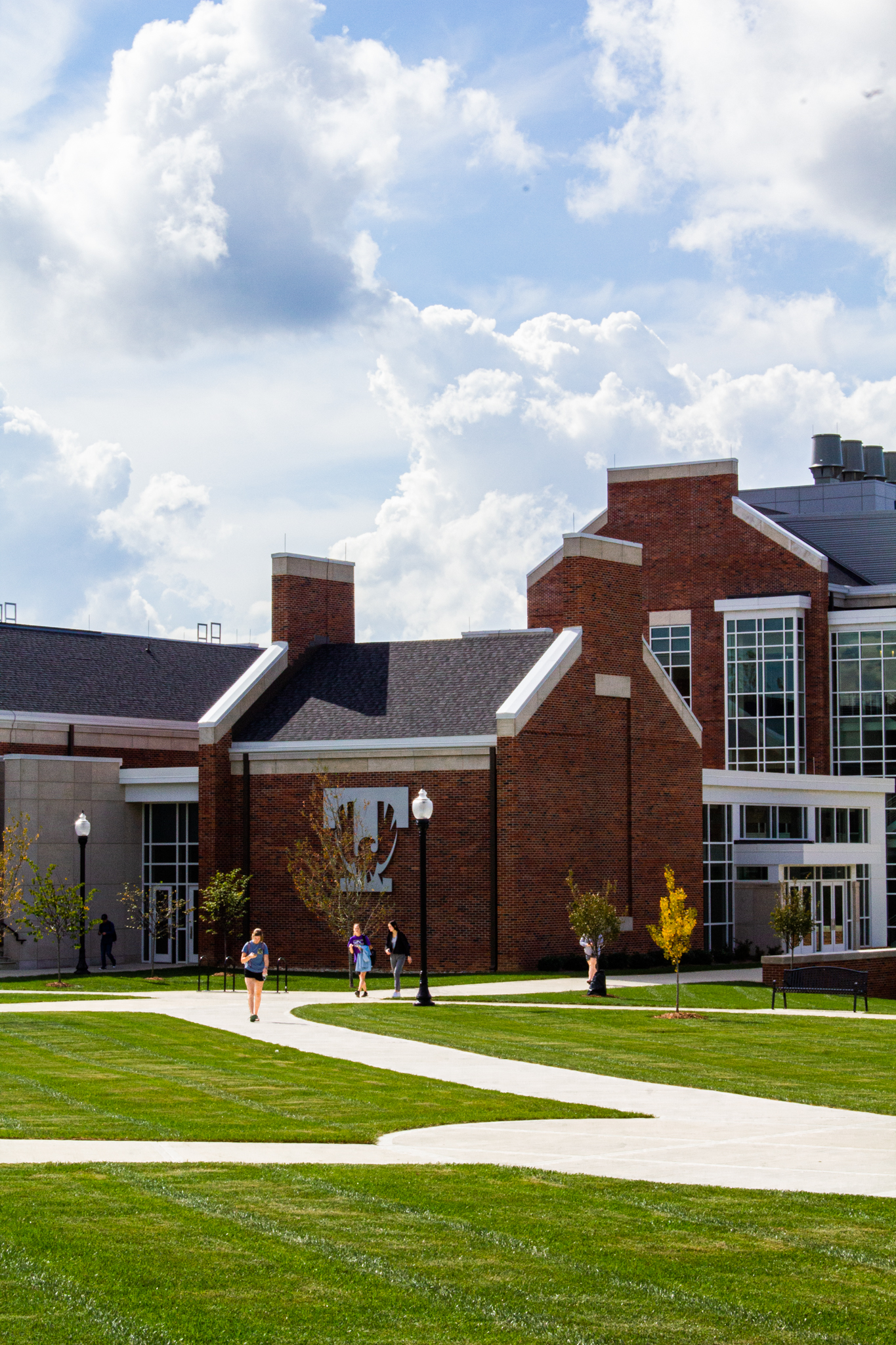Students walk in front of Stonecipher Lecture Hall on a sunny October day.